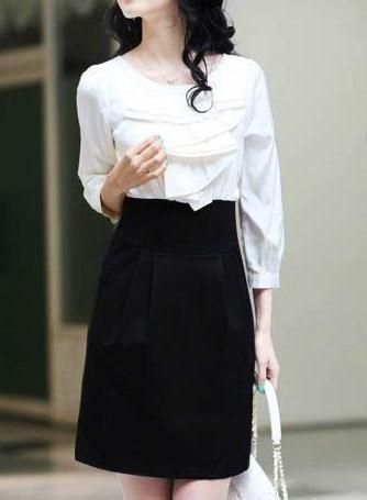 Модное платье с длиными рукавами чёрного цвета.