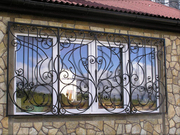 Кованые решетки на окна Киев,  козырёк над входом,  заборы,  перила