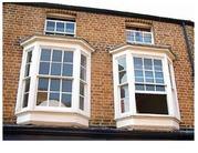 Английские вертикально-сдвижные окна из дерева .