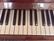 Продам пианино Украина коричневого цвета.