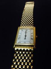 Продам Золотые часы Geneve